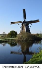 Dutch wind mill painted by Piet Mondriaan near Amsterdam reflected in water