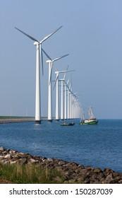 Dutch wind turbines with fishing ship