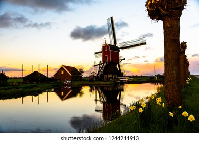 Dutch Windmill during Sunrise
