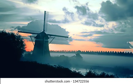 dutch windmill landscape by early morning