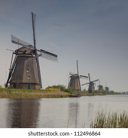 Dutch windmill near canal.