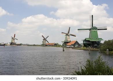 Dutch windmill on a canals edge