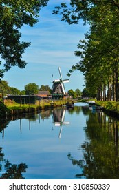 Dutch windmill seen from a river perspective