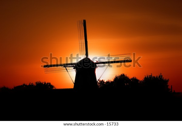 A Dutch Windmill at sunset, the mill is located in Kinderdijk the Netherlands