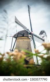 Dutch windmill and surrounding landscape at Kinderdijk in Netherlands