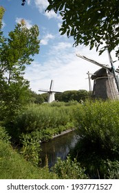 Dutch windmill in a typical dutch landscape