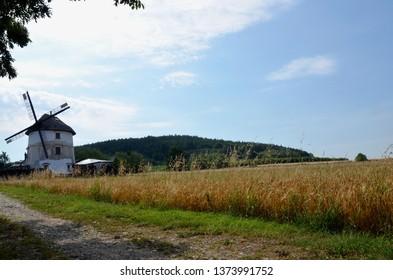 Dutch windmill in the village Gogołów in Ślężański Landscape Park in Poland, on the background of farmland