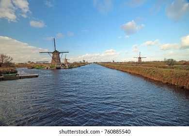 Dutch windmills along the water in the famous Kinderdijk area which is Unesco Heritage protected.