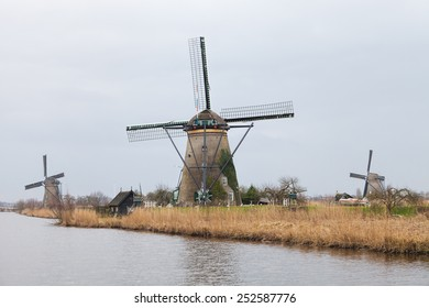 Dutch windmills with canal reflections at Kinderdijk, Netherlands