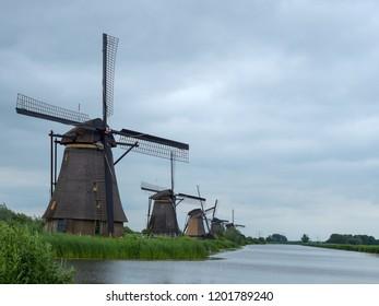 Dutch windmills near small river in Kinderdijk landscape, Netherlands