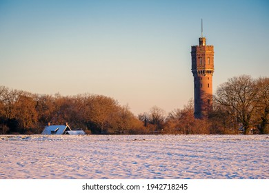 Dutch winter landscape with the water tower of Delden, in the eastern part of The Netherlands. Snow has fallen on a cold February day. The cities of Almelo and Hengelo and the German border are near.