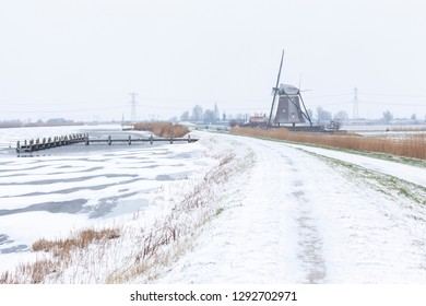 Dutch winter landscape with windmill along river Rotte
