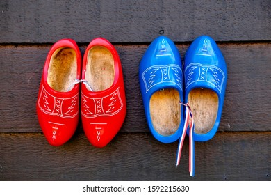 Dutch wooden shoes on brown wooden background