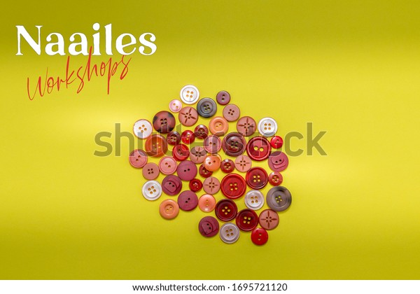 Dutch word Naailes (sewing lessons) and workshops with a pile of buttons in red colors on a yellow background. Room for text.