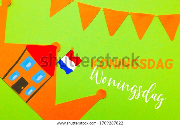 Dutch words Koningsdag (Kings day) and Woningsdag (Home day) with an orange paper crown and orange flags on a green background.