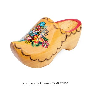 Dutch yellow wooden shoes over white background