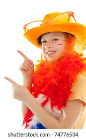 Dutch young girl dressed up as soccer supporter or queensday is pointing over white background