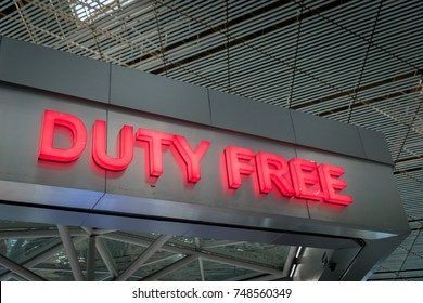 duty free shop sign inside of an international airport