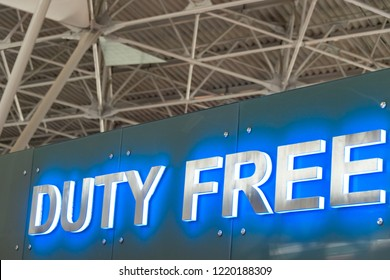 Duty free sign at arport shop. Roof of airport. Metal beams and ceiling. Blue and white inscription.