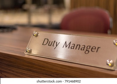 Duty manager sign on table in hotel reception lobby