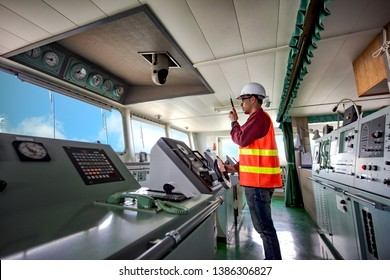 duty officer in charge handle of the ship navigating to the port destination, navigation on the bridge of the ship vessel under voyage sailing to the sea