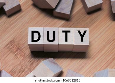 DUTY Word Written In Wooden Cube