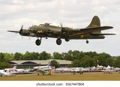 DUXFORD, CAMBRIDGESHIRE, UK - JULY 11, 2015: Boeing B-17G Flying Fortress 124485 DF-A Memphis Belle Sally B (G-BEDF) takes off out of Duxford airfield during the Flying Legends Airshow.