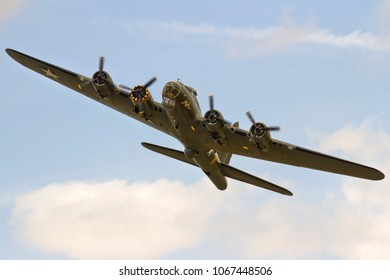 DUXFORD, CAMBRIDGESHIRE, UK - JULY 11, 2015: Boeing B-17G Flying Fortress 124485 DF-A Memphis Belle Sally B (G-BEDF) carries out a display at Duxford airfield during the Flying Legends Airshow.