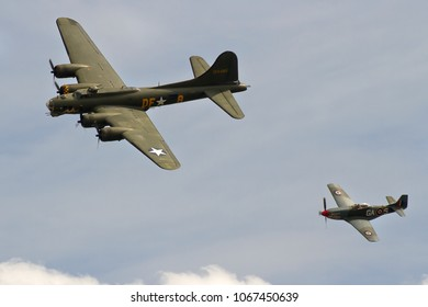 DUXFORD, CAMBRIDGESHIRE, UK - JULY 11, 2015: Boeing B-17G Flying Fortress 124485 DF-A Memphis Belle Sally B (G-BEDF) displays alongside North American P-51D Mustang at Duxford during Flying Legends.