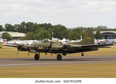 DUXFORD, CAMBRIDGESHIRE, UK - JULY 11, 2015: Boeing B-17G Flying Fortress 124485 DF-A Memphis Belle Sally B (G-BEDF) taxis in after landing at Duxford airfield during the Flying Legends Airshow.