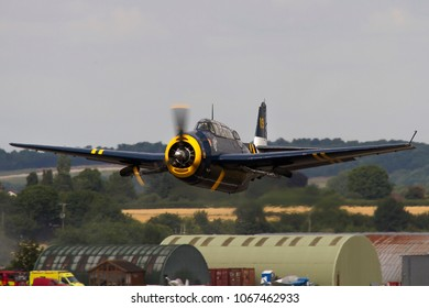 DUXFORD, CAMBRIDGESHIRE, UK - JULY 11, 2015: Grumman TBM-3R Avenger HB-RDG takes off out of Duxford airfield during the Flying Legends Airshow.