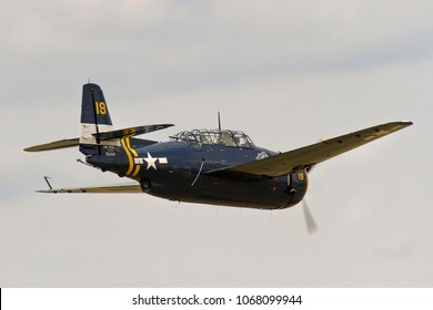 DUXFORD, CAMBRIDGESHIRE, UK - JULY 11, 2015: Grumman TBM-3R Avenger HB-RDG carries out a display at Duxford airfield during the Flying Legends Airshow.
