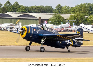 DUXFORD, CAMBRIDGESHIRE, UK - JULY 11, 2015: Grumman TBM-3R Avenger HB-RDG taxis in after landing at Duxford airfield during the Flying Legends Airshow.