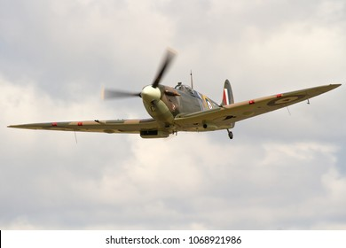 DUXFORD, CAMBRIDGESHIRE, UK - JULY 11, 2015: Supermarine Spitfire Mk. Vb BM597 JH-C (G-MKVB), marked as 317 Sqn at RAF Woodvale, carries out a display at Duxford airfield during Flying Legends.