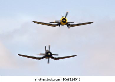 DUXFORD, CAMBRIDGESHIRE, UK - JULY 11, 2015: Chance Vought F4U-5N Corsair 123176/19-WF (F-AZYS) and Goodyear FG-1D Corsair KD345 / A-13 (G-FGID) display together at Duxford during Flying Legends.