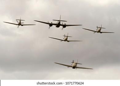 DUXFORD, CAMBRIDGESHIRE, UK - JULY 11, 2015: Bristol Blenheim Mk. I YP-Q L6739 (G-BPIV) flies in formation with 3 Mk I Supermarine Spitfires, and a Mk. XIIa Hawker Hurricane, during Flying Legends.