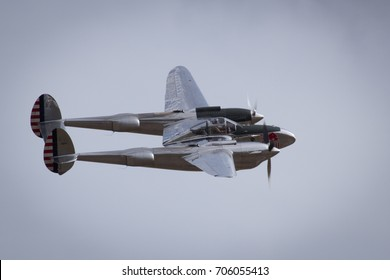 Duxford, Cambridgeshire, UK - July 12th, 2015: The Red Bull Lockheed P-38 Lightning performs at Duxford Flying Legends