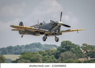 DUXFORD, CAMBRIDGESHIRE, UK - JULY 14, 2018: Duxford airfield during Flying Legends. Supermarine Spitfire Mk IXb (G-ASJV)