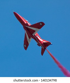 DUXFORD, CAMBRIDGESHIRE, UK - MAY 26: A member of the Red Arrow display team flying a BAe Hawk trainer flying on May 26, 2013 at the Air Show at Duxford, Cambridgeshire, UK