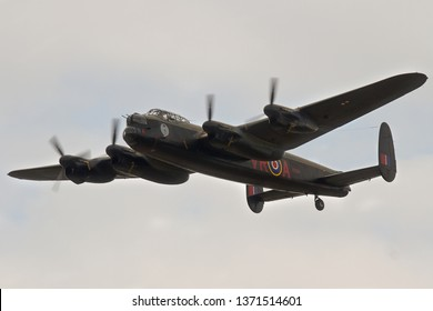 DUXFORD, CAMBRIDGESHIRE, UK - SEPTEMBER 14, 2014: Canadian Warplane Heritage Museum's Avro Lancaster Mark X KB726 C-GVRA displays over Duxford, during a month long visit to fly with the RAF Lancaster.