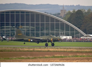DUXFORD, CAMBRIDGESHIRE, UK - SEPTEMBER 14, 2014: Boeing B-17G Flying Fortress 124485 DF-A Memphis Belle Sally B (G-BEDF) takes off to carry out a display at Duxford in Cambridgeshire.
