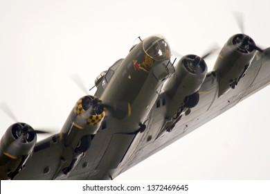 DUXFORD, CAMBRIDGESHIRE, UK - SEPTEMBER 14, 2014: Boeing B-17G Flying Fortress 124485 DF-A Memphis Belle Sally B (G-BEDF) carries out a display at Duxford in Cambridgeshire.