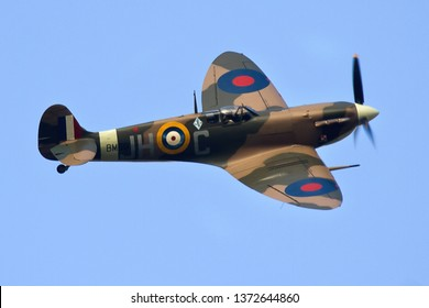 DUXFORD, CAMBRIDGESHIRE, UK - SEPTEMBER 14, 2014:  Supermarine Spitfire Mk. Vb BM597 JH-C (G-MKVB), marked as 317 Sqn at RAF Woodvale, displays over Duxford.