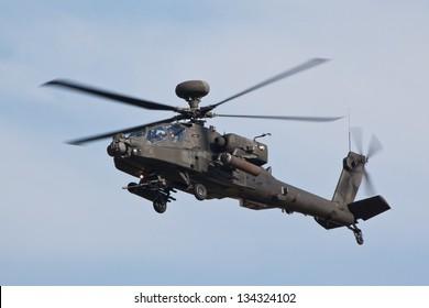 DUXFORD, CAMBRIDGESHIRE, UK - SEPTEMBER 3: Apache AH-64 flying on September 3, 2011 the  air display at Duxford, Cambridgeshire, UK.
