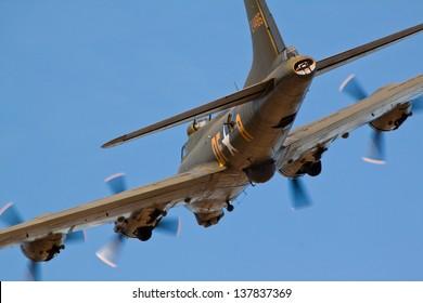 "DUXFORD, CAMBRIDGESHIRE, UK - SEPTEMBER 8: Boeing B-17G Flying Fortress ""Sally B"" flying on September 8, 2012 at the Duxford Air Show at Duxford, Cambridgeshire, UK."