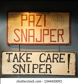 "DUXFORD CAMBRIDGESHIRE/UK APRIL 10 2018 A ""Take Care - Sniper"" sign from Sniper Alley in Sarajevo during the Bosnian Wars"
