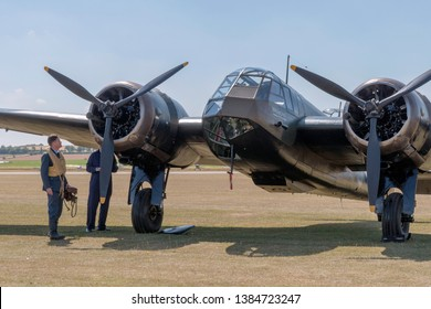 Duxford, Cambridgeshire/United Kingdom - 07/07/2018: RAF re-enactor pilot and mechanic examine a Bristol Blenheim at Duxford Flying Legends 2018
