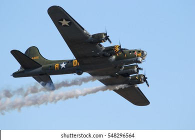 DUXFORD, ENGLAND - SEPTEMBER 11, 2016: B-17 Sally B painted as the Memphis Belle smoking from two engines at the Duxford Meet the Fighters airshow.