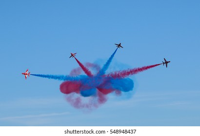 DUXFORD, ENGLAND - SEPTEMBER 11, 2016: The RAF Red Arrows display team performing the Gypo Break at the Duxford Meet the Fighters airshow
