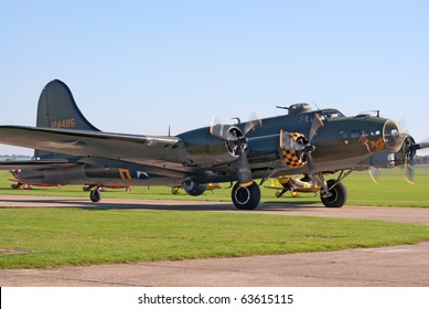 """DUXFORD, UK - OCTOBER 10: B-17 Flying Fortress """"Sally B"""" bomber taxis for takeoff during Autumn Air Show on October 10, 2010 in Duxford, UK"""